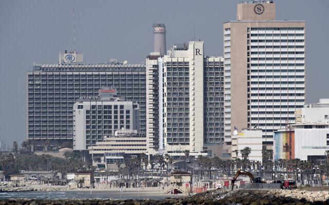 Hotels on Tel Aviv's coastline are seen from Jaffa on March 26, 2020 (Gili Yaari /Flash90)