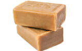 Two pieces of brown soap. (vovashevchuk/iStock by Getty Images)
