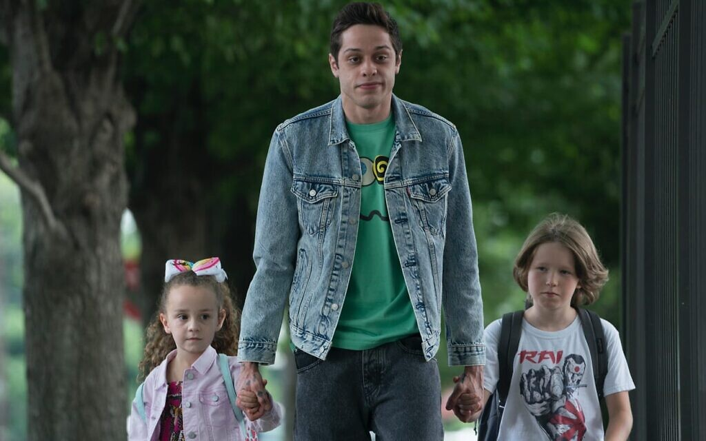Pete Davidson, center, in a still from Judd Apatow's 'The King of Staten Island.' (Courtesy Universal Films)