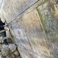Archaeologist Joe Uziel cleans the newly uncovered Western Wall courses, located under Wilson's Arch in the Jerusalem Old City, October 2017. (Yaniv Berman/Israel Antiquities Authority)