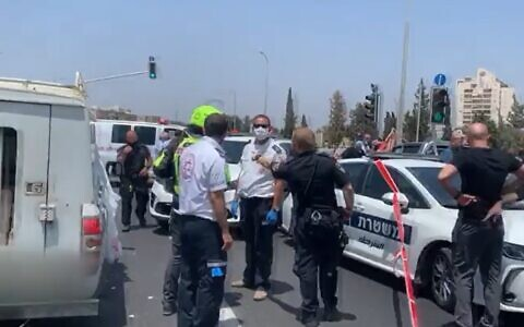 Police and medics at the scene of a drive-by shooting near the central city of Lod, June 6, 2020 (Screen grab/Channel 12 news)
