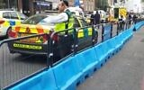 Medics at the scene of a stabbing of an ultra-Orthodox man in London on June 12, 2020. (Screen capture/Twitter)