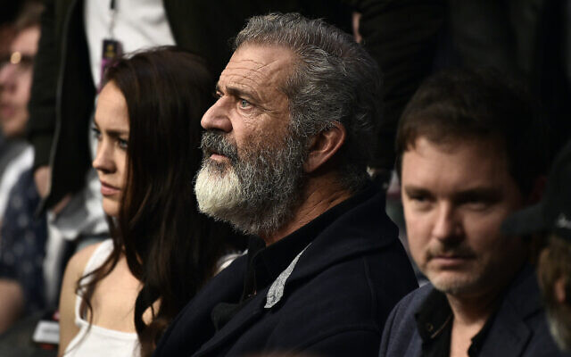 Mel Gibson at a UFC event with his partner Rosalind Ross in Las Vegas, Dec. 14, 2019. (Chris Unger/Zuffa LLC/Getty Images via JTA)
