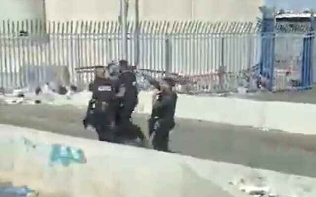 Palestinian man is detained at the Qalandiya checkpoint after he was found to be carrying a knife, June 27, 2020 (Screen grab/Kann)