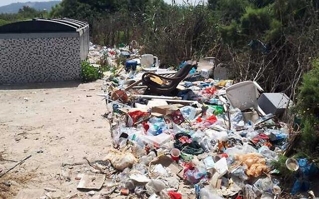 Trash gathered by the side of a dumpster, from a presentation by MK Miki Haimovich during a Knesset Interior Affairs and Environment Committee meeting on waste, June 2, 2020. (Yael Levi-Efrat, Society for the Protection of Nature in Israel)