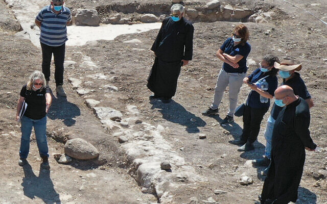 Head of the Greek Catholic Church, Youssef Matta, during his visit to the excavation site of 1,300-year-old church in the village of Kfar Kama, near Mount Tabor. (Anya Kleiner, Israel Antiquities Authority