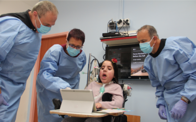 Microsoft's Yaron Galitzky, right to left, with 12-year old Lina, Dr. Maurit Beeri, Director General of ALYN Hospital, and Arie Yekel-Melamed, who manages the hospital's innovation initiatives (Courtesy)