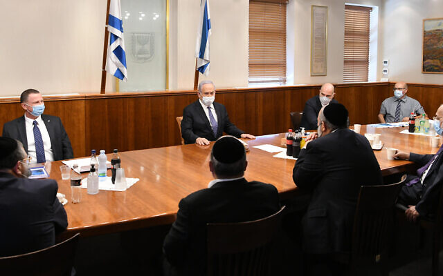 Prime Minister Benjamin Netanyahu meets with Health Minister Yuli Edelstein, Public Security Minister Amir Ohana, Interior Minister Aryeh Deri and ultra-Orthodox MKs to discuss the government's coronavirus responser on July 13, 2020. (Amos Ben Gershom/GPO)