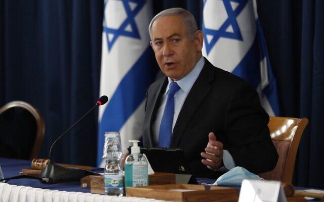 Prime Minister Benjamin Netanyahu chairs the weekly cabinet meeting in Jerusalem on June 28, 2020. (Ronen Zvulun/Pool/AFP)