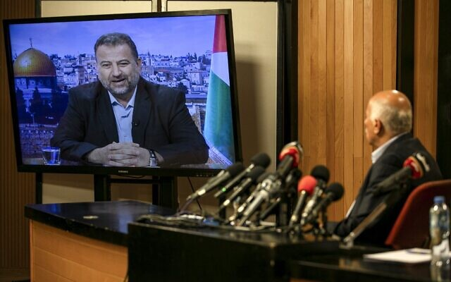 Senior Fatah official Jibril Rajoub, in the West Bank city of Ramallah, attends by video conference a meeting with deputy Hamas chief Saleh Arouri (on screen from Beirut) discussing Israel's plan to annex parts of the West Bank, on July 2, 2020. (Abbas Momani/AFP)