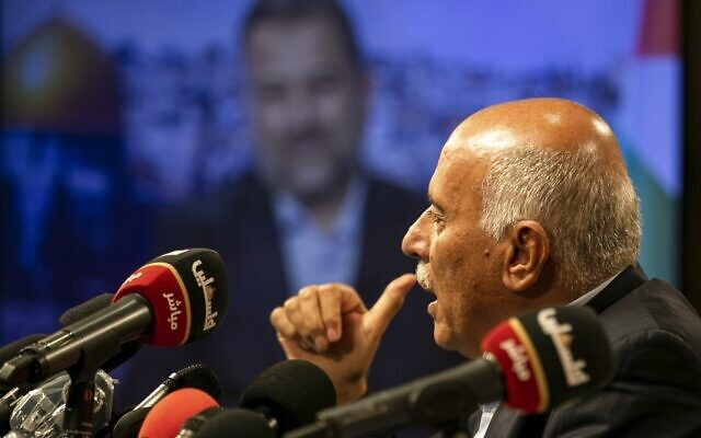 Senior Fatah official Jibril Rajoub, in the West Bank city of Ramallah, hosts by video conference a meeting with deputy Hamas chief Saleh Arouri (on screen from Beirut) discussing Israel's plan to annex parts of the West Bank, on July 2, 2020. (ABBAS MOMANI / AFP)