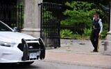 Canadian police stand guard outside Rideau Hall in Ottawa, Canada on July 2, 2020, after an armed man who entered the grounds was arrested in the property that is home to Prime Minister Justin Trudeau and the country's governor general (Mohamed KADRI / AFP)