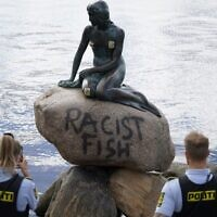 Danish police officers take pictures of the base of the Little Mermaid statue (Den lille Havfrue) after it was vandalized on July 3, 2020. (Mads Claus Rasmussen / Ritzau Scanpix / AFP) / Denmark OUT