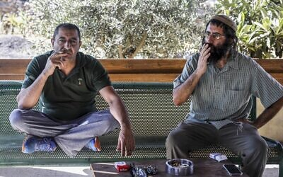 Khaled Abu Awad (L), a Palestinian from Bethlehem, and Shaul Judelman, an Israeli from the nearby Teqoa settlement, who are both co-directors of movement of settlers and Palestinians called 'Shorashim-Judur' (Hebrew and Arabic for 'Roots') pose, during an interview at the Gush Etzion Junction in the West Bank on July 3, 2020. (MENAHEM KAHANA/AFP)