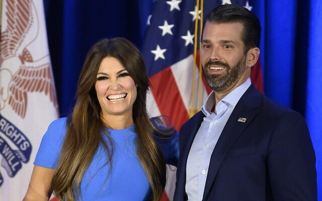 In this file photo taken on February 3, 2020 Donald Trump Jr. (R) and his girlfriend Kimberly Guilfoyle smile during a 'Keep Iowa Great' press conference in Des Moines, Iowa (JIM WATSON / AFP)