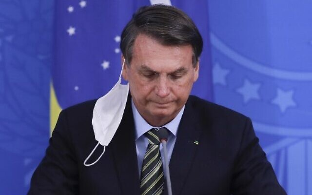 In this file photo taken on March 18, 2020 Brazilian President Jair Bolsonaro gestures during a press conference regarding the COVID-19 coronavirus pandemic at the Planalto Palace, Brasilia. (Sergio LIMA / AFP)
