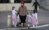 Ultra-Orthodox Jews walk in the West Bank Settlement of Beitar Illit on July 8, 2020 (MENAHEM KAHANA / AFP)