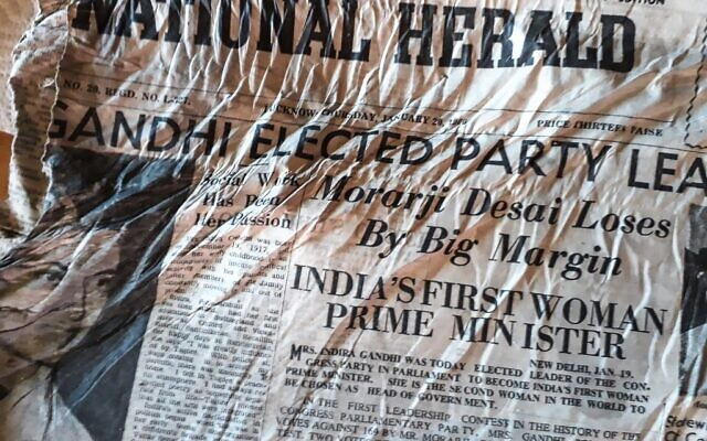 """A picture taken on July 9, 2020, at the Bossons glacier near Chamonix in the French Alps, shows a 1966 copy of Indian newspaper The Herald with a healdline announcing the election of Indira Gandhi, likely to have been on board the Air India Boeing 707 """"Kangchenjunga"""" aircraft that crashed in the nearby Mont Blanc massif on January 24, 1966 (Bernard BARRON / AFP)"""