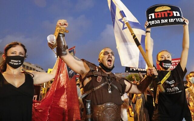 Israelis protest in Tel Aviv's Rabin Square against the government's economic policies during the coronavirus pandemic, July 11, 2020. (Jack Guez/AFP)