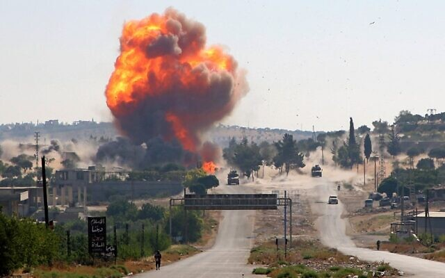 A fireball erupts from the site of an explosion that reportedly targeted a joint Turkish-Russian patrol on the strategic M4 highway, near the Syrian town of Ariha in the rebel-held northwestern Idlib province, on July 14, 2020. (Mohammed Al-Rifai/AFP)
