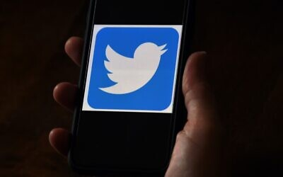 In this file photo illustration, a Twitter logo is displayed on a mobile phone on May 27, 2020, in Arlington, Virginia. (Olivier DOULIERY / AFP)