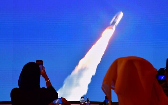 A picture taken on July 19, 2020, shows a screen broadcasting the launch in Japan of the Hope Mars probe at the Mohammed Bin Rashid Space Center in Dubai. (Giuseppe CACACE / AFP)