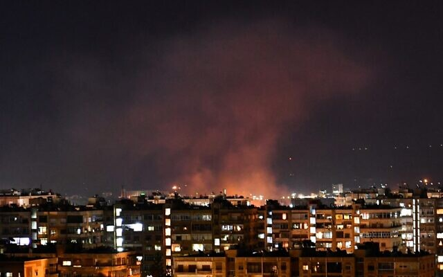 Smoke billows following an alleged Israeli airstrike targeting south of Damascus, Syria, on July 20, 2020 (AFP)