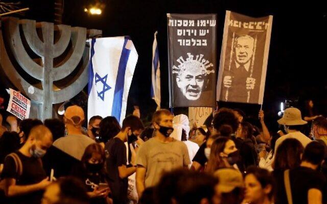 Israelis protest against Prime Minister Benjamin Netanyahu in Jerusalem, on July 21, 2020. (Photo by Ahmad GHARABLI / AFP)