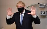 Britain's Prime Minister Boris Johnson gestures during his visit to the Tollgate Medical Centre in Becton, east London on July 24, 2020. (Jeremy Selwyn/POOL/AFP)