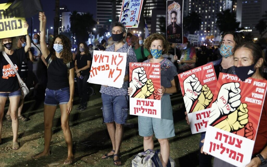 Israelis protest against Prime Minister Benjamin Netanyahu and the government's economic policies during the COVID-19 pandemic in Tel Aviv on July 25, 2020. (Jack Guez/AFP)