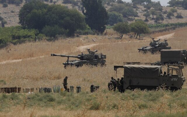Armored vehicles and 155 mm self-propelled howitzers are deployed in the Upper Galilee in northern Israel on the border with Lebanon on July 27, 2020. (JALAA MAREY / AFP)