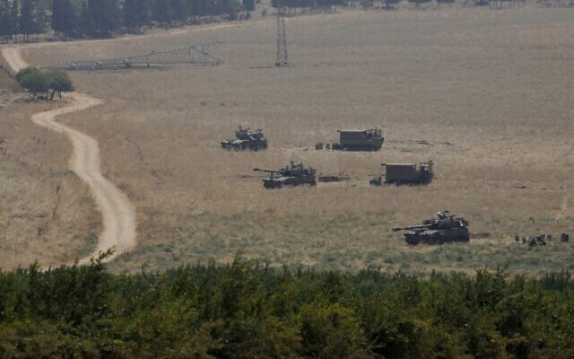 Armored vehicles and 155 mm self-propelled howitzers are deployed in the Upper Galilee in northern Israel on the border with Lebanon on July 27, 2020 (JALAA MAREY / AFP)