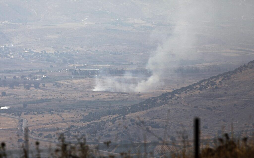 A picture taken from the Israeli side of the Blue Line that separates Israel and Lebanon shows smoke billowing above the Shebaa Farms sector after clashes in the border area, on July 27, 2020. (Jalaa MAREY / AFP)