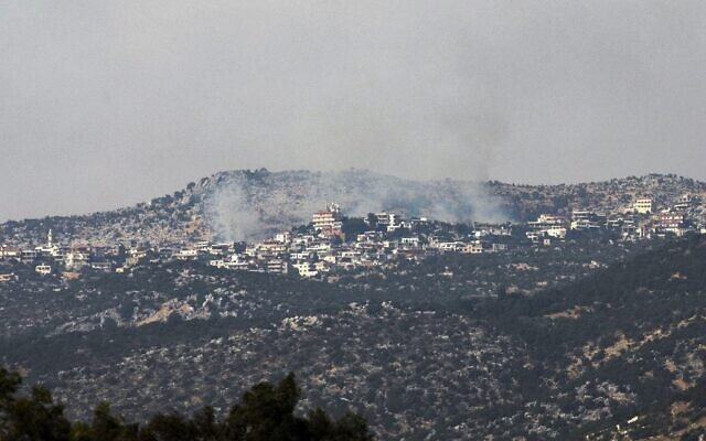 A picture taken from the Israeli side of the Blue Line that separates Israel and Lebanon shows smoke billowing above Mount Dov on the Israeli-Lebanese border, after reports of clashes between the IDF and Hezbollah in the area, on July 27, 2020. (Jalaa MAREY / AFP)