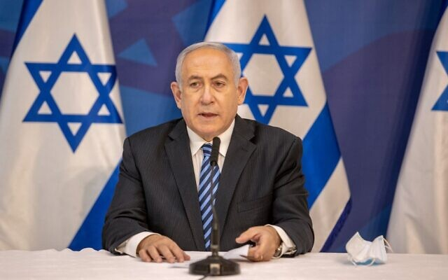 Prime Minister Benjamin Netanyahu gives a televised statement at the Defense Ministry in Tel Aviv on July 27, 2020. (Tal Shahar/Pool/AFP)