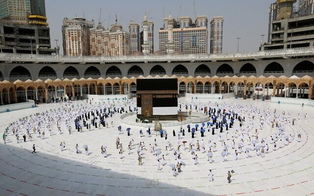 Pilgrims circumambulating around the Kaaba, Islam's holiest shrine, at the centre of the Grand Mosque in the holy city of Mecca, at the start of the annual Muslim Hajj pilgrimage, July 29, 2020. (STR / AFP)