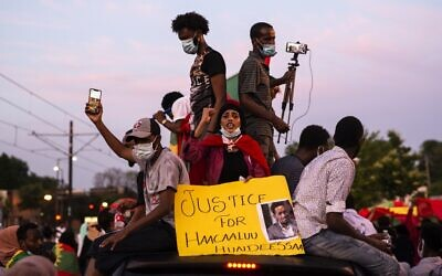Demonstrators march down University Avenue during a protest after the death of musician and activist Hachalu Hundessa on the westbound lane of Interstate 94 on July 1, 2020 in St Paul, Minnesota. (Stephen Maturen/Getty Images/AFP)