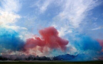 Red and blue smoke obscures the White House as part of a Fourth of July celebration July 4, 2020 in Washington, DC. (Win McNamee/Getty Images/AFP)