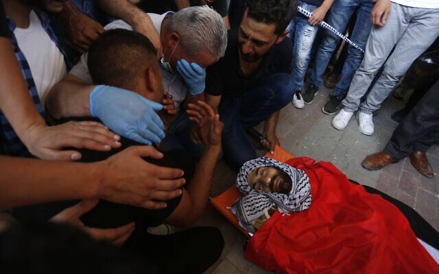 Mourners at the funeral of Ibrahim Abu Yaqoub, 29, who was shot in unclear circumstances in the West Bank, on July 10, 2020 (WAFA)