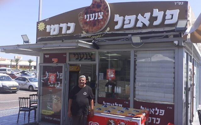 Falafel vendor Yuval Carmi in front of his store, June 9, 2020. (Anat Peled/Times of Israel)