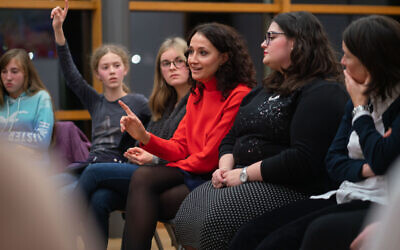 Illustrative: Volunteers with a program now called Meet a Jew talk with non-Jewish students at a school in Frankfurt, November 5, 2019. (Frank Rumpenhorst/picture alliance via Getty Images/ via JTA)