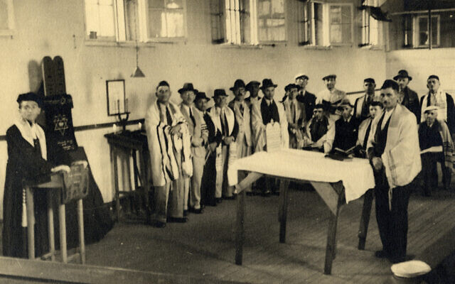 A group of men praying at one of the synagogues set up in the prison in Beau Bassin (Courtesy Ghetto Fighters' House Archives, Israel)