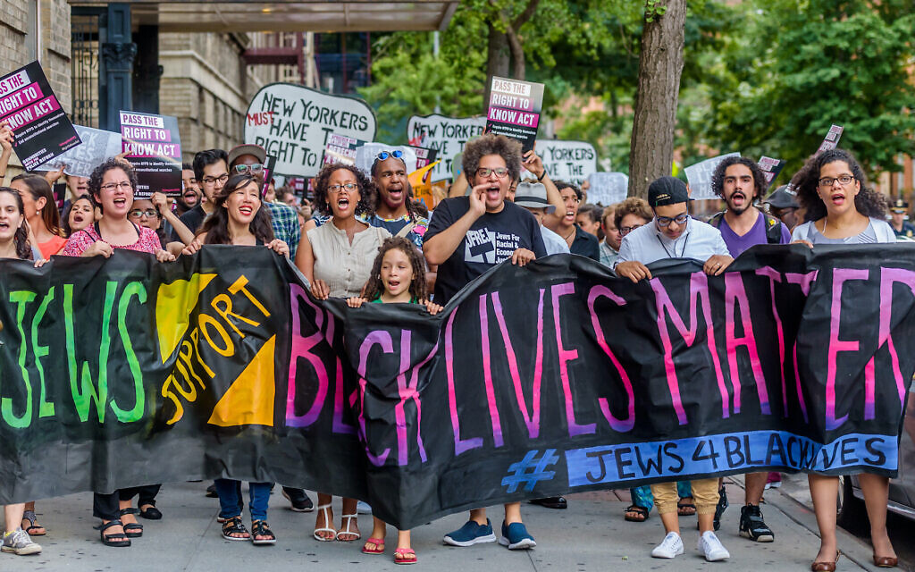 Members of Jews for Racial and Economic Justice, including in the front row April Baskin, on the far right and Leo Ferguson, third from right, march as part of a Jews4BlackLives protest in New York in 2016. (Erik McGregor/Pacific Press/LightRocket via Getty Images/ via JTA)