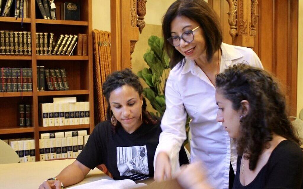 Rabbi Mira Rivera, center, talks to students at Ammud: The JOC Torah Academy. (Courtesy of Ammud/ via JTA)