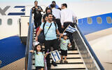 New immigrants from North America arrive on a flight arranged by the Nefesh B'Nefesh organization at Ben Gurion airport in central Israel on Aug. 14, 2019. (Flash90)