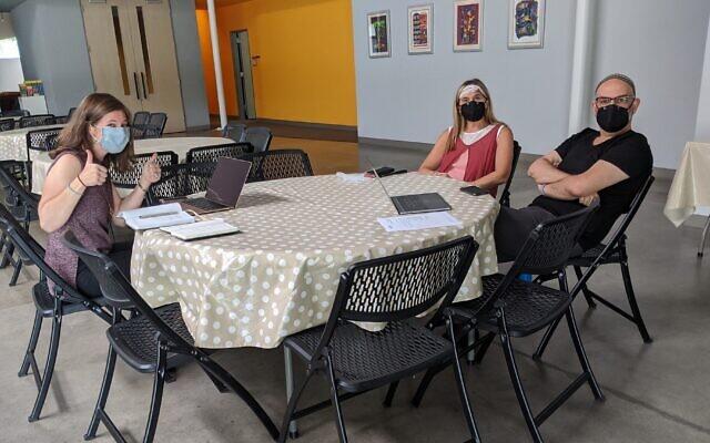 Rabbi Lauren Henderson, left, meets with outgoing Or Hadash rabbis Analia Bortz and Mario Karpuj. (Courtesy of Henderson/ via JTA)