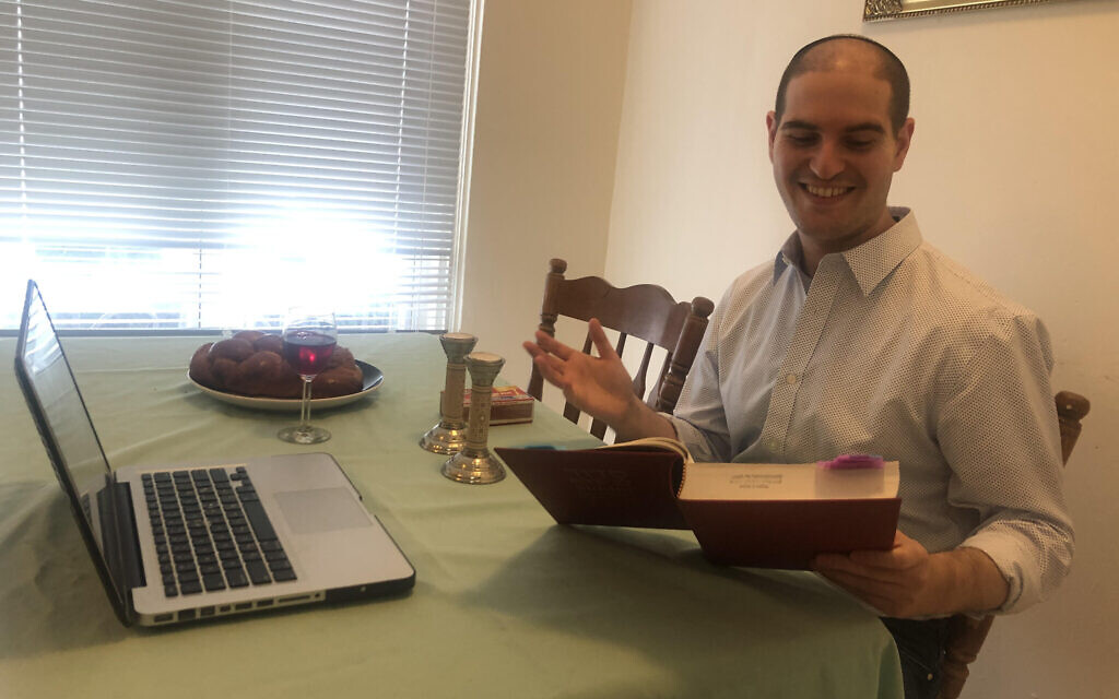 Rabbi Michael Perice leads virtual services for his new synagogue in New Jersey from his home in Philadelphia. (Courtesy of Perice/ via JTA)