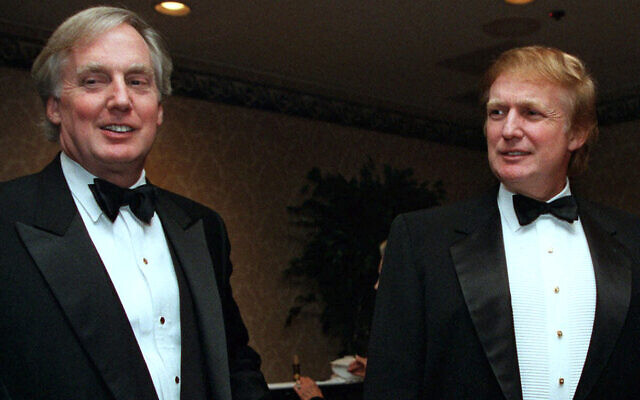 In this Nov. 3, 1999 file photo, Robert Trump, left, joins real estate developer and presidential hopeful Donald Trump at an event in New York.  (AP Photo/Diane Bonadreff, File)