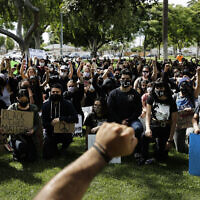 In this June 1, 2020, file photo, demonstrators raise their fists during a protest over the death of George Floyd in Anaheim, Calif.  (AP Photo/Jae C. Hong, File)