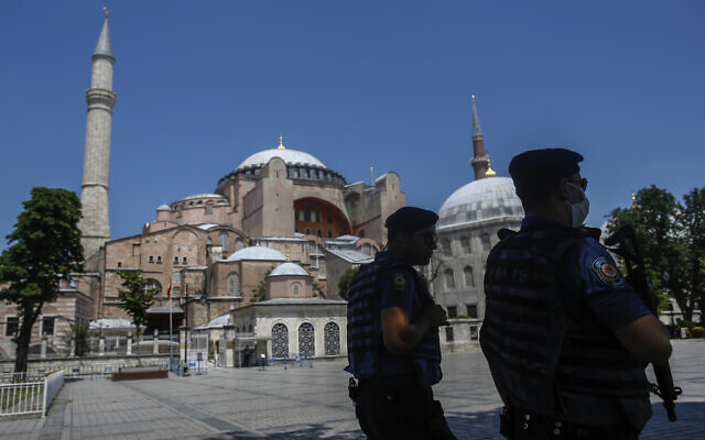 Armed police patrol outside the Byzantine-era Hagia Sophia, one of Istanbul's main tourist attractions in the historic Sultanahmet district of Istanbul, Thursday, June 25, 2020.  (AP Photo/Emrah Gurel)